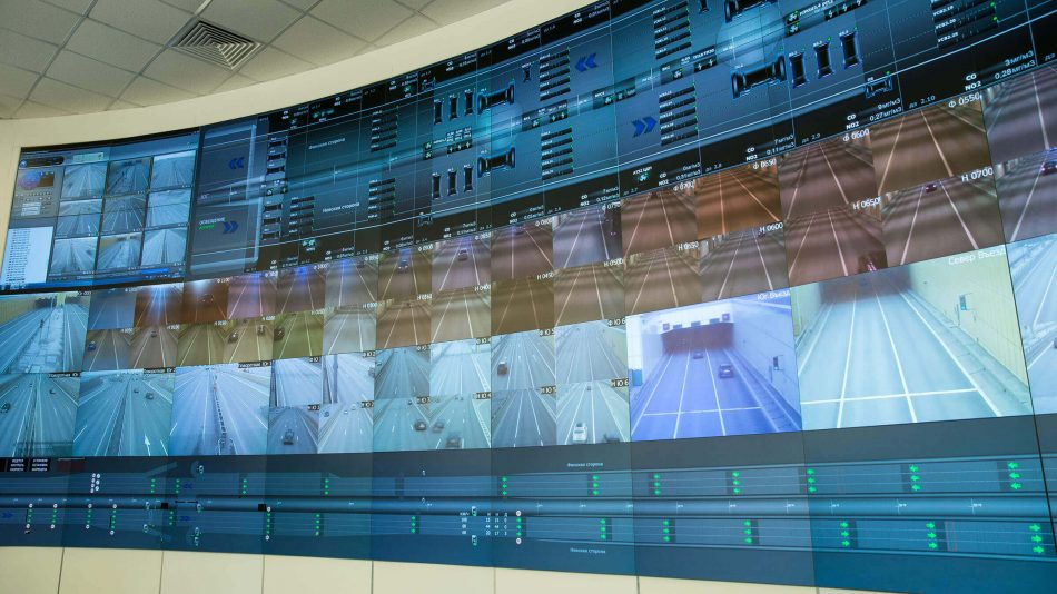 A large video wall with numerous screens showing multiple video feeds to demonstrate Senstar's Network Video Recorders capabilities