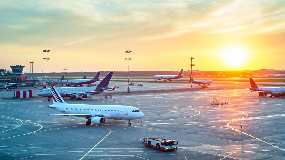 Several planes on the tarmac at an airport at sunset to demonstrate Senstar's ability to protect airports from intrusions and manage and analyze video surveillance